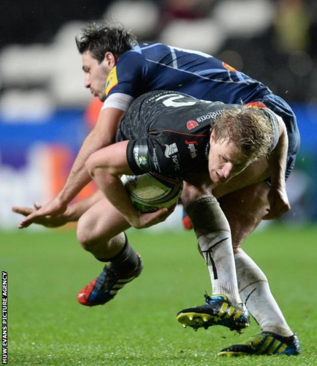 Ben John is tackled by Castres wing Paul Bonnefond as the Ospreys secured their first win of the Heineken Cup campaign with a 21-12 victory.