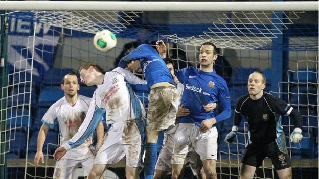 Ballymena defender Aaron Stewart fails to prevent Glenavon's Rhys Marshall getting a header on goal during the scoreless draw
