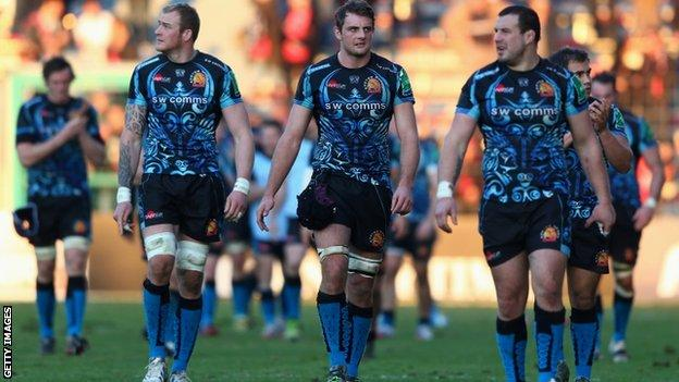 Exeter Chiefs players trudge off after their defeat by Toulon