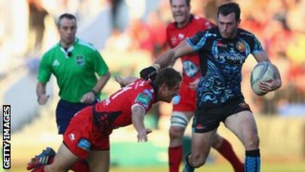 Luke Arscott tries to evade Jonny Wilkinson's tackle