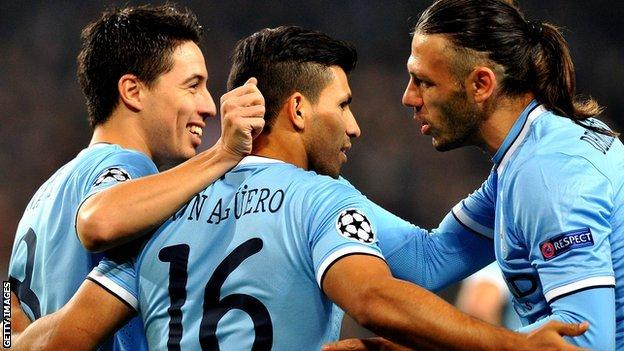Man City players celebrate in the Champions League