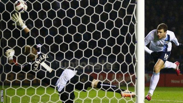 Edin Dzeko scores from Manchester City