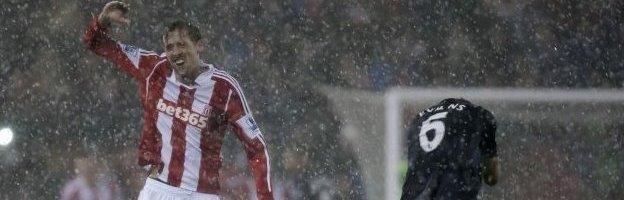 Peter Crouch shields himself from the hail