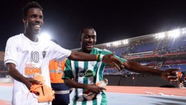 Kouko Guehi and Vivien Mabide of Casablanca celebrate with the boots of Ronaldinho