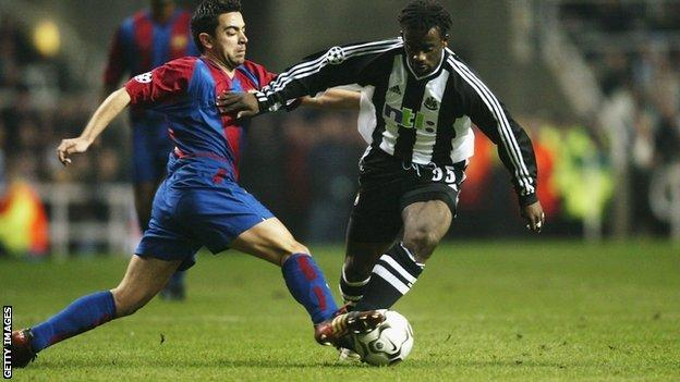 Olivier Bernard of Newcastle United skips past Xavi of Barcelona during the UEFA Champions League in 2003