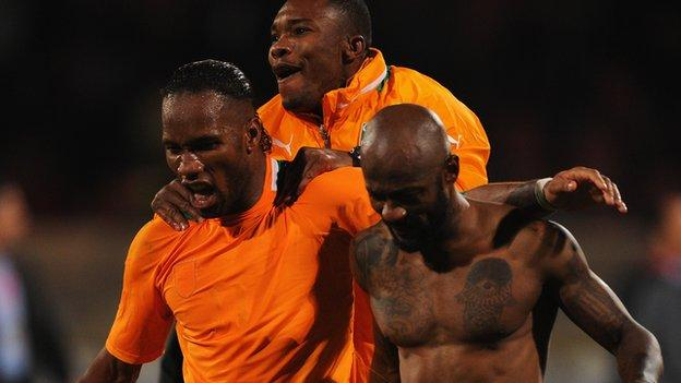 Ivory Coast players celebrate their World Cup play-off win over Senegal