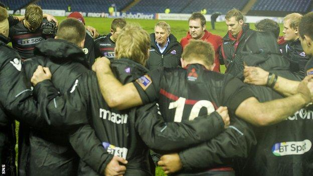 Head coach Alan Solomons addresses the Edinburgh players after an 11-6 win over Leinster