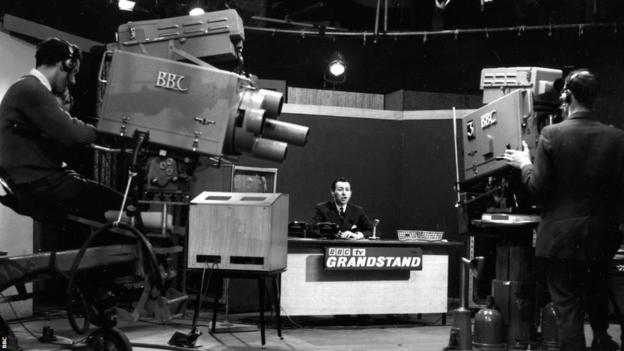 David Coleman introduces another edition of the programme Grandstand in 1959.