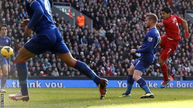 Liverpool striker Luis Suarez (right) volleys in against Cardiff at Anfield