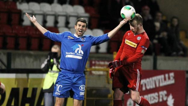 Steve Feeney and Liam Boyce in action during Cliftonville's 1-0 win over Ballinamallard