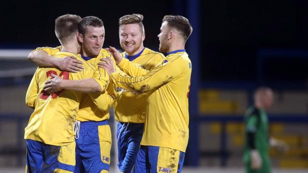Dungannon players congratulate Stefan Lavery on scoring the Swifts's second goal against Coleraine
