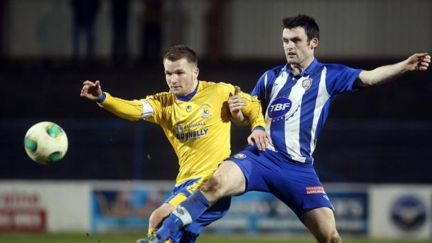 Ryan Harpur and Eoin Bradley keep their eyes on the ball at Ballycastle Road