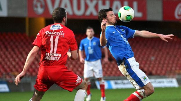 Portadown's Tim Mouncey prepares to challenge Linfield's Philip Lowry during the Blues' 3-2 victory at Windsor Park