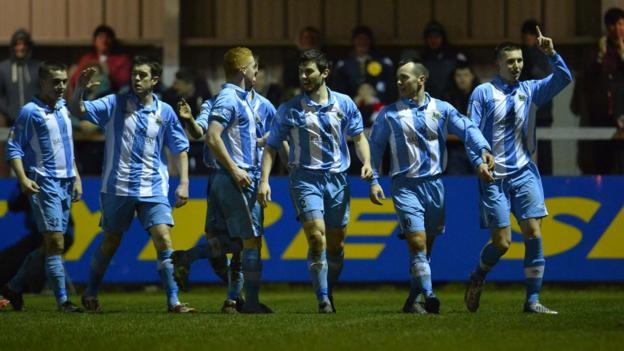 Warrenpoint Town players queue up to congratulate goal-scorer Daniel Hughes at Milltown