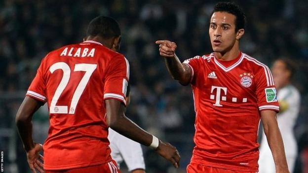 Thiago Alcantara of Bayern Munich celebrates with David Alaba after scoring his team's second goal during the Fifa Club World Cup Final against Raja Casablanca at Marrakech Stadium