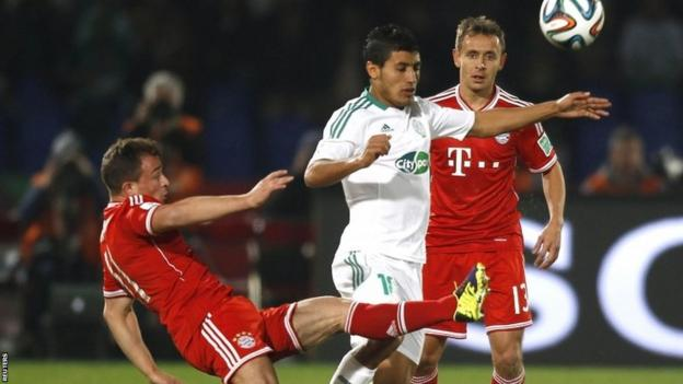 Abdelilah Hafidi (centre) of Morocco's Raja Casablanca fights for the ball with Xherdan Shaqiri (left) of Germany's Bayern Munich during the Fifa Club World Cup final