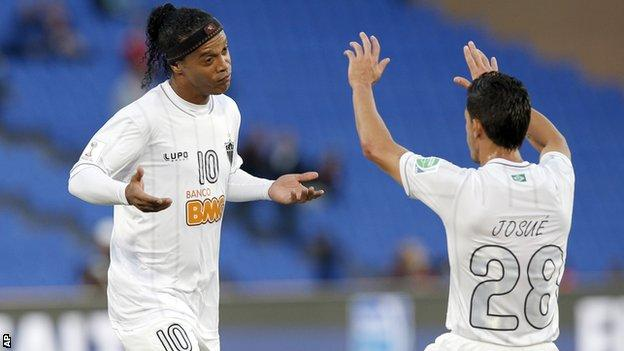 Atletico Mineiro's Ronaldinho (left) celebrates with Josue after scoring against Guangzhou Evergrande in the Club World Cup soccer tournament in Marrakech, Morocco