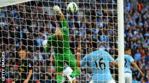 Ben Watson heads past Joe Hart in the FA Cup final