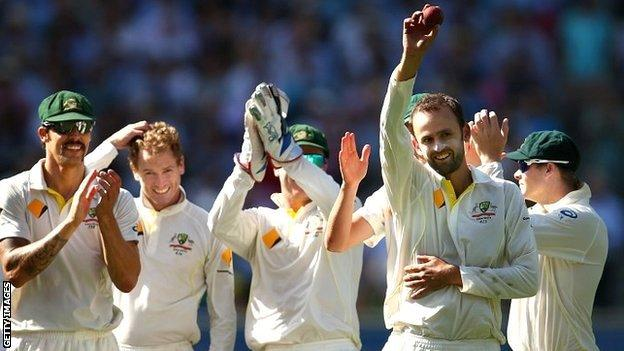 Nathan Lyon celebrates his fifth wicket