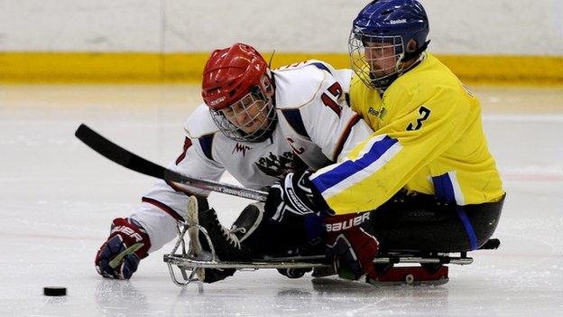 Sweden and Russia play sledge hockey
