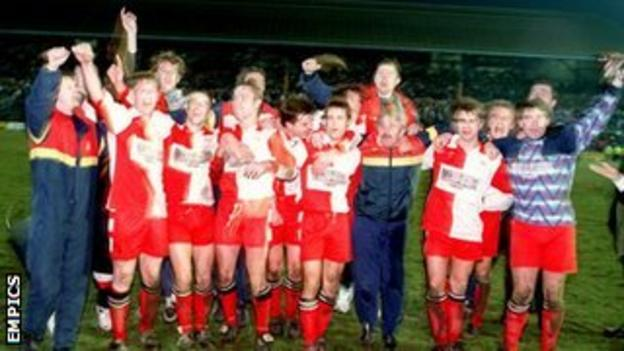 Kidderminster Harriers players celebrate their 2-1 FA Cup third round win at St Andrew's