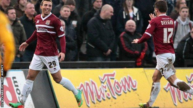 Northampton's Hallam Hope celebrates his side's opener at Newport County