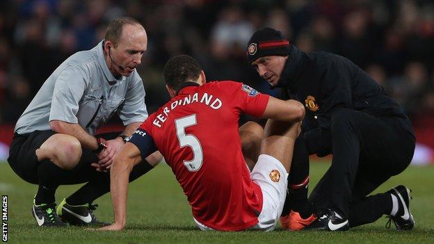 Manchester United defender Rio Ferdinand receives treatment during the defeat by Swansea