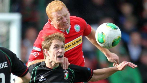 Joe McNeill gets above Glentoran's David Howland