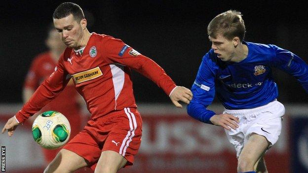 Cliftonville winger Martin Donnelly shields the ball from Chris Curran