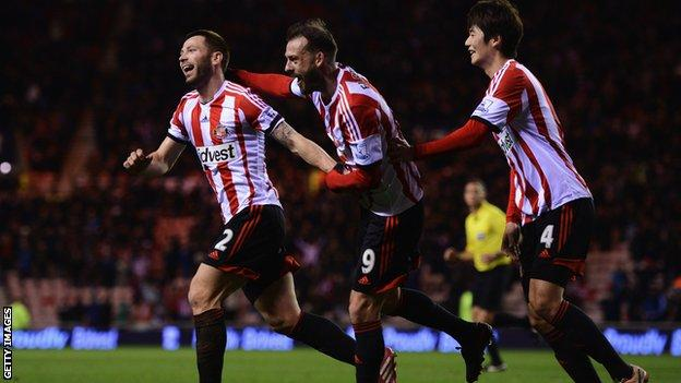 Phil Bardsley of Sunderland (left) celebrates Ryan Giggs of Manchester United scoring an own-goal