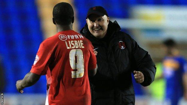 Russell Slade (r) celebrates with Kevin Lisbie after Leyton Orient's 2-0 win at Shrewsbury
