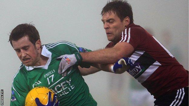 Fermanagh's Niall McElroy is challenged by James Duffy of St Mary's at Brewster Park.