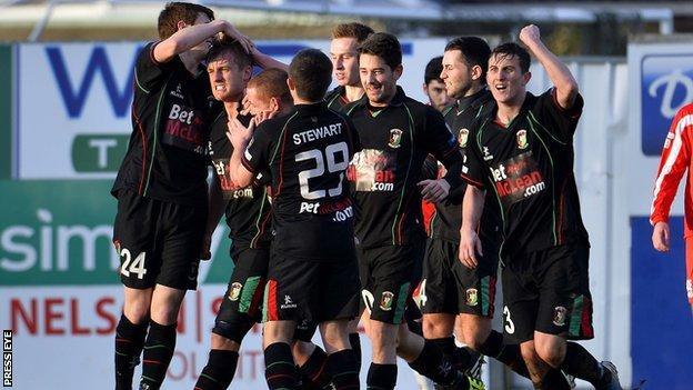 Glentoran celebrate one of their three goals at Portadown