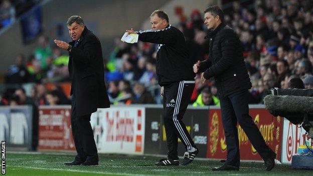 West Ham boss Sam Allardyce (L), his assistant Neil McDonald and new Cardiff manager Ole Gunnar Solskjaer (R)
