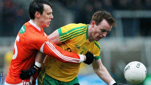 Armagh's Mark Shields with challenges Eamonn Doherty of Donegal