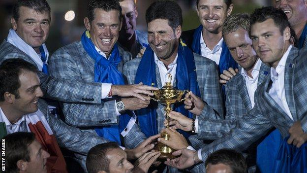 Members of Team Europe pose with the Ryder Cup after the final day of the 39th Ryder Cup at the Medinah Country Club September 30, 2012