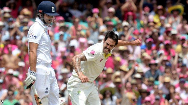 England captain Alastair Cook (left) is dismissed by Australia bowler Mitchell Johnson during the Ashes