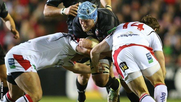 Leicester number eight Jordan Crane hammers into the Ulster defence