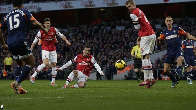Santi Cazorla (centre) scores the opener for Arsenal against Fulham