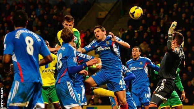Ryan Bennett heads Norwich's late winner