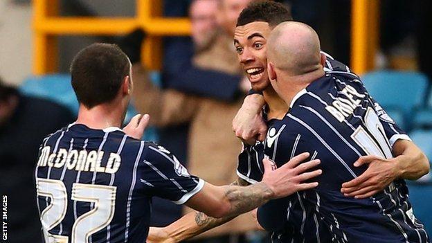 Ryan Fredericks (centre) celebrates his goal for Millwall