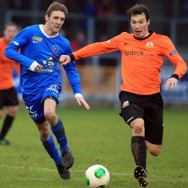 Ballinamallard United striker Andy Crawford battles fro possession against Kyle Neill of Glenavon