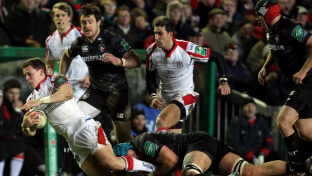 Ulster wing Craig Gilroy is stopped in his tracks by Graham Kitchener as he attempts to make a break for the Leicester line