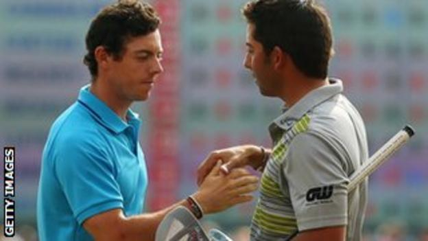 Pablo Larrazabal (right) is congratulated by Rory Mcilroy after winning the Abu Dhabi HSBC Golf Championship