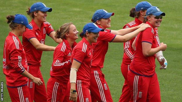Anya Shrubsole and Danielle Wyatt of England celebrate the wicket of Jessica Cameron of Australia with their teammates.