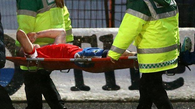 Aaron Burns is carried off during Saturday's win at Ballymena