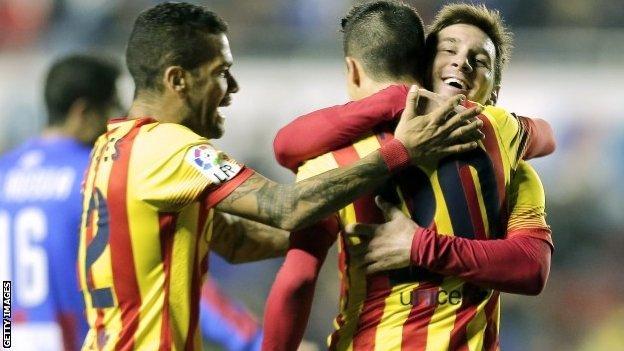 "Barcelona's forward Cristian Tello (second right) celebrates his third goal with Barcelona""s Argentine forward Lionel Messi (right)"
