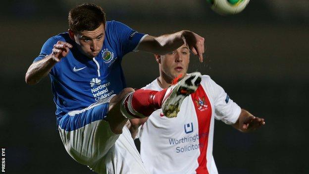 Billy Joe Burns battles with Mark McClelland during the County Antrim Shield clash between Linfield and Ards in September