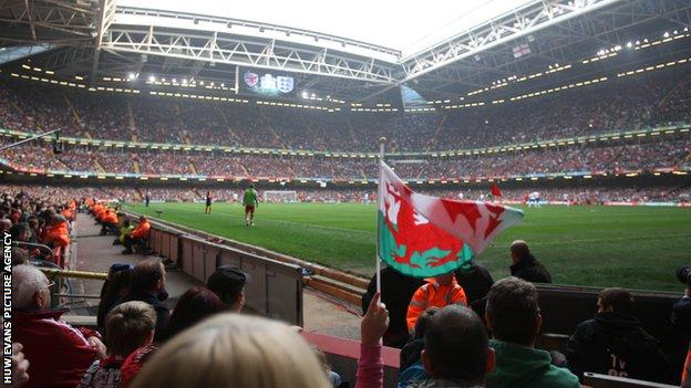 Fans watching Wales v England in the Euro 2012 qualifiers at the Millennium Stadium