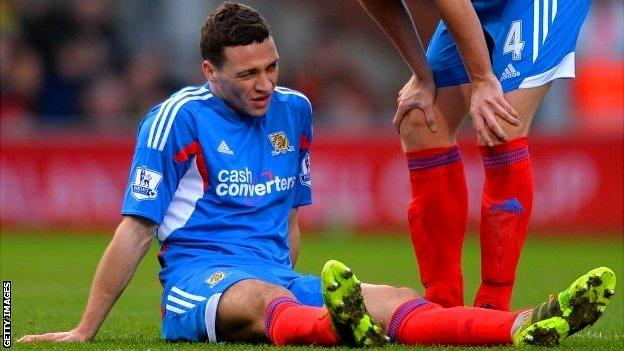 James Chester of Hull City sits on the pitch injured